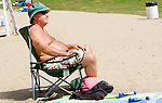 WOLCOTT CT. 17 August 2015-081715SV04-Tom O&rsquo;Dea of Wolcott catches a tan at the Woodtick Recreation area in Wolcott Monday. <br /> Steven Valenti Republican-American