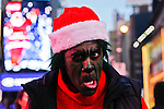 A man dressed as Grinch takes part at the Santacon's Annual Festival at Times Square in New York, United States. 14/12/2012. Photo by ZAMEK