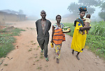 Residents of the Congolese village of Wembo Nyama walking in the early morning.