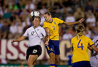 Lauren Cheney (12) of the USWNT goes up for a header in the box against Charlotte Rohlin (2) of Sweden at Rentschler Field in East Hartford, Connecticut.  The USWNT defeated Sweden, 3-0.