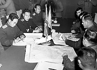 Col. James Murray, Jr., USMC, and Col. Chang Chun San, of the North Korean Communist Army, initial maps showing the north and south boundaries of the demarcation zone, during the Panmunjom cease fire talks.  October 11, 1951. F. Kazukaitis. (Navy)<br /> NARA FILE #:  080-G-437021<br /> WAR &amp; CONFLICT BOOK #:  1516