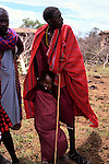 Africa, Kenya, Maasai Mara. Maasai elder and child at Olanana.