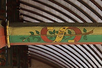 Beam painted with the motto of Nicolas Rolin, Seule and a star, architectural detail of the painted wooden ceiling in the shape of a boat's hull, with dragons' heads and caricatures of local people, in the Salle des Povres or Room of the Poor, almost 50m long, in Les Hospices de Beaune, or Hotel-Dieu de Beaune, a charitable almshouse and hospital for the poor, built 1443-57 by Flemish architect Jacques Wiscrer, and founded by Nicolas Rolin, chancellor of Burgundy, and his wife Guigone de Salins, in Beaune, Cote d'Or, Burgundy, France. The hospital was run by the nuns of the order of Les Soeurs Hospitalieres de Beaune, and remained a hospital until the 1970s. The building now houses the Musee de l'Histoire de la Medecine, or Museum of the History of Medicine, and is listed as a historic monument. Picture by Manuel Cohen