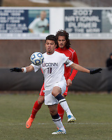 University of Connecticut midfielder Carlos Alvarez (10) controls the ball..NCAA Tournament. With a goal in the second overtime, University of Connecticut (white) defeated University of New Mexico (red), 2-1, at Morrone Stadium at University of Connecticut on November 25, 2012.