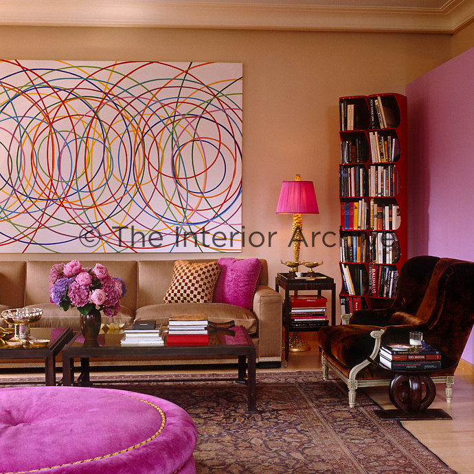 The gold, pink and rich brown palette of this living room is enhanced by the use of sumptous textiles
