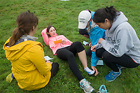 A medical situation, being acted out by Sierra Trejos, from left, Jacqueline Wade, Danielle Leahy, Alyssa Kwok. Outdoor team building activities. Wilderness medicine.