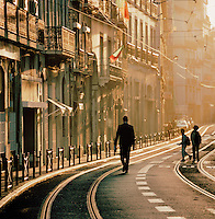 A man walking down a main street in downtown Lisbon, Portugal