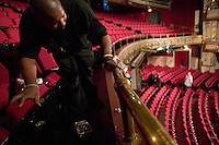13 February 2006 - New York City, NY - Kevin Jacobs (L) cleans the brass railing at the Apollo theater in Harlem, New York City, USA, 13 February 2006. The famous theater, home of the Amateur Nights at The Apollo, is reopening with a renovated facade and new seats.