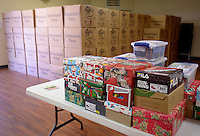 NWA Democrat-Gazette/BEN GOFF @NWABENGOFF<br /> Individual boxes waiting to be crated sit on a table on Thursday Nov. 19, 2015 at the Operation Christmas Child Northwest Arkansas Collection Center at Calvary Chapel in the Ozarks in Rogers. Operation Christmas Child shoe boxes collected from relay centers at area churches are crated and brought to the collection center where they will be shipped to Denver, Colo. for processing and distribution.