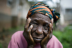 BUKAVU, DEMOCRATIC REPUBLIC OF CONGO - OCTOBER 29: An unidentified woman sits outside a ward as she waits for surgery on October 29, 2007 at Panzi hospital outside Bukavu, DRC. Many of the women in the hospital has been raped and abused by rebels and government soldiers. About 10 women and girls show up at the hospital every day and Dr. Denis Mukwege, a gynecologist and his staff does up to 20 reconstructive operations every day. He often has to perform complicated surgery to reproductive and digestive parts of the women. The DRC conflict has seen an unprecedented high rate of rape and sexual abuse of women. The culprits are both different rebel groups and government soldiers and very few are punished. About 27,000 sexual assaults were reported in South Kivu province alone in 2006, according to the United Nations. (Photo by Per-Anders Pettersson)