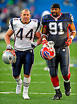 28 December 2008: New England Patriots' fullback Heath Evans leaves the field of play with Buffalo Bills' defensive tackle Spencer Johnson after a game at Ralph Wilson Stadium in Orchard Park, NY. The Patriots kept their playoff hopes alive defeating the Bills 13-0 in their 16th win against Buffalo of their past 17 meetings. ***** Editorial Use Only ******..Mandatory Photo Credit: Ed Wolfstein Photo