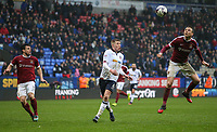 Northampton Town's Matthew Taylor clears a cross intended for Bolton Wanderers' Josh Vela<br /> <br /> Photographer Alex Dodd/CameraSport<br /> <br /> The EFL Sky Bet League One - Bolton Wanderers v Northampton Town - Saturday 18th March 2017 - Macron Stadium - Bolton<br /> <br /> World Copyright &copy; 2017 CameraSport. All rights reserved. 43 Linden Ave. Countesthorpe. Leicester. England. LE8 5PG - Tel: +44 (0) 116 277 4147 - admin@camerasport.com - www.camerasport.com