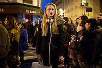 PARIS, FRANCE - NOVEMBER 14: A young woman under shock in front of the restaurant Petit Cambodge where 12 people died  during the attack of the November 13, 2015 at rue Albert. The attacks of the 13th of November killed 129 people in Paris and injured 352 .