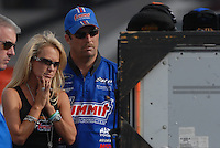 Nov 4, 2007; Pomona, CA, USA; NHRA pro stock racer Greg Anderson watches round two of eliminations with his wife. Anderson lost the championship when Jeg Coughlin Jr won his race during the Auto Club Finals at Auto Club Raceway at Pomona. Mandatory Credit: Mark J. Rebilas-US PRESSWIRE