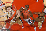 5 APR 2004: UConn center Emeka Okafor (#50) pulls down one of his 15 rebounds in the game in front of Georgia Tech center Luke Schenscher (#12) during the Division I Men's Basketball championship game held at the Alamodome in San Antonio, TX. The University of Connecticut defeated Georgia Tech 82-73 for the championship title. Ryan McKee/NCAA Photos