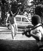 Hall of Fame baseball player Tony Gywnn takes the role of pitcher and tosses a whiffle ball to his son, Tony Jr. at their home in Poway, California. Tony Jr is now an outfielder for the Philadelphia Phillies.