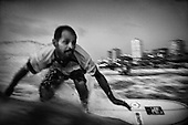 Mohammed Abu Jayab, 38, rides a wave off Gaza City, Gaza. Abu Jayab is the leader of a surf group in Gaza and one of the pioneers of the sport in the coastal enclave.