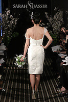 Model walks runway in an Allure wedding dress by Sarah Jassir, for the Sarah Jassir Fall 2011 - Desire bridal collection.