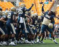 Pitt defensive lineman Khaynin Mosley-Smith fires up the team and leads them onto the field. The Pitt Panthers football team defeated the Youngstown State Penguins 45-37 on Saturday, September 5, 2015 at Heinz Field, Pittsburgh, Pennsylvania.