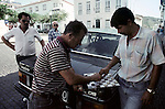 Taxi drivers play a game of chess while waiting for customers on Terceira, Azores. Far out in the Atlantic Ocean, some 850 miles off the western coast of Lisbon, Portugal lies the 425-mile long archipelago of the Azores. (Jim Bryant Photo).....