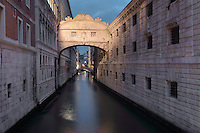 The Ponte dei Sospiri or Bridge of Sighs, 1600, designed by Antonio Contino, Venice, Italy. The bridge spans the Rio di Palazzo and connects the New Prison or Prigioni Nuove to the interrogation rooms in the Doge's Palace. The enclosed limestone bridge is so named as this would be the last view of Venice for prisoners on the way to their cells. The city of Venice is an archipelago of 117 small islands separated by canals and linked by bridges, in the Venetian Lagoon. The historical centre of Venice is listed as a UNESCO World Heritage Site. Picture by Manuel Cohen