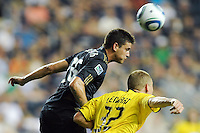 Cristian Arrieta (26) of the Philadelphia Union heads the ball over Steven Lenhart (32) of the Columbus Crew. The Columbus Crew defeated the Philadelphia Union 2-1 during a Major League Soccer (MLS) match at PPL Park in Chester, PA, on August 05, 2010.