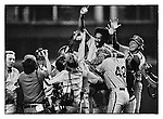 Philadelphia Phillies Gary Maddox is hoisted by his teammates after they clinched the National League title by defeating the Houston Astros in the Astrodome September 1980.