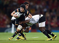 Matthew Morgan of Wales is tackled in possession. Rugby World Cup Pool A match between Wales and Fiji on October 1, 2015 at the Millennium Stadium in Cardiff, Wales. Photo by: Patrick Khachfe / Onside Images
