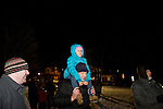 TORRINGTON, CT- 28 November 2014-112814EC04--   Adam Crawford and his daughter Sabine, 5, watch the Coe Memorial Park tree lighting along withhundreds of others in downtown Torrington Friday night. Mayor Elinor Carbone helped countdown to the lighting, then attendees walked down Main Street to see the City Hall tree lit and hear music. Erin Covey Republican-American