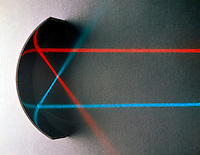 CONCAVE MIRROR FOCUSES PARALLEL LIGHT RAYS<br /> Parallel rays strike a concave mirror and are reflected through the focal point, which is midway between the center of curvature and the mirror.