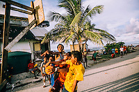 Youths playing basketball, one of the most popular sports among young people on the island. Several dozen makeshift basketball courts have been constructed on the island.