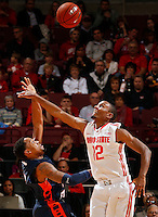 Morgan State Bears guard Justin Black (5) gets his shot blocked by Ohio State Buckeyes forward Sam Thompson (12) during the 1st half of their game at The Value City Arena at the Jerome Schottenstein Center on November 9, 2013.  (Dispatch photo by Kyle Robertson)