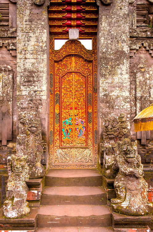 The main entrance door to the inner temple at the Hindu temple of Ulun Danu at Candikuning, on Bali, Indonesia.  The door is normally closed to the public.  The temple at Candikuning is one of the iconic images of Bali, Indonesia.  Located in the high hills of the Bedugul, about 30 miles north of Bali's capital city of Denpasar, the temple is built on the shores of the crater Lake Bratan (formed from the sunken crater of a long-dormant volcano).  Much of the inner precincts of the temple is closed to the (non-Hindu) public, but the gardens are spectacular and feature fabulous shrines, statuary, and views.