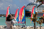Caribbean, Bahamas, Castaway Cay. Woman taking picture at Castaway Cay.