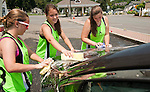 WINSTED, CT--- -070515JS01-- Members of the Dauntless fast pitch softball team, from left, Penelope Rein, Anna King and Hannah Crowley, clean a vehicle during  a fundraiser car wash Sunday in Winsted. The team, who participate in the Northern Connecticut Girls Softball League, were raising money for team expenses for the season which runs through August. <br /> Jim Shannon Republican-American