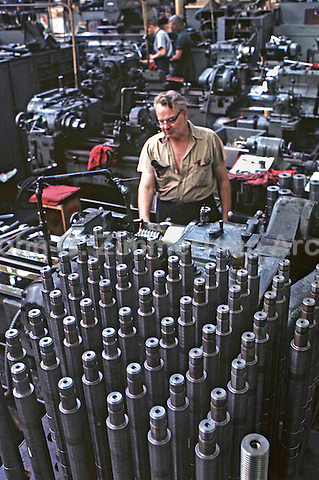 Workers at Gary Steel Works, US Steel Corporation, Gary, Indiana, 1966. Forty thousand different sizes and shapes of steel parts were turned out at a single plant for use in automotive, metal parts components, home construction and appliance markets. Photo by John G. Zimmerman.