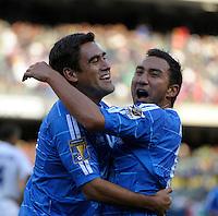 El Salvador's Arturo Alvarez (right) celebrates with El Salvador's Eliseo Quintanilla after scoring a goal.  El Salvador defeated Cuba 6-1 at the 2011 CONCACAF Gold Cup at Soldier Field in Chicago, IL on June 12, 2011.