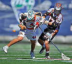 23 August 2008: Los Angeles Riptide Defenseman Greg Bice (44) tries to take possession over Midfielder Benson Erwin (37) of the Denver Outlaws during the Semi-Finals of the Major League Lacrosse Championship Weekend at Harvard Stadium in Boston, MA. The Outlaws edged out the Riptide 13-12, advancing to the upcoming Championship Game.. .Mandatory Photo Credit: Ed Wolfstein Photo