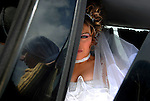 Arwad Abu Shaheen sits at her wedding car, as she leaves her home and Israel to marry her fiancé in Syria.