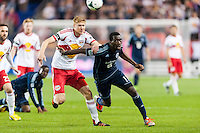 Markus Holgersson (5) of the New York Red Bulls and C.J. Sapong (17) of Sporting Kansas City battle for the ball. Sporting Kansas City defeated the New York Red Bulls 1-0 during a Major League Soccer (MLS) match at Red Bull Arena in Harrison, NJ, on April 17, 2013.