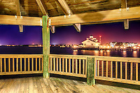 Photograph of the Manteo skyline at night, captured from a gazebo in  the harbor.