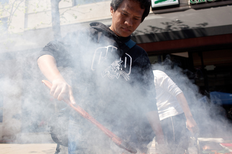 Yusram Darmawam cooks at the International Street Fair on Court Street in Athens, Ohio on Saturday, April 20, 2013. Photo by Chris Franz