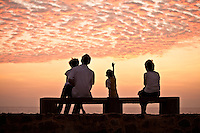 A family watches a fabulous sunset from the ramparts of the old fort. (Photo by Matt Considine - Images of Asia Collection)
