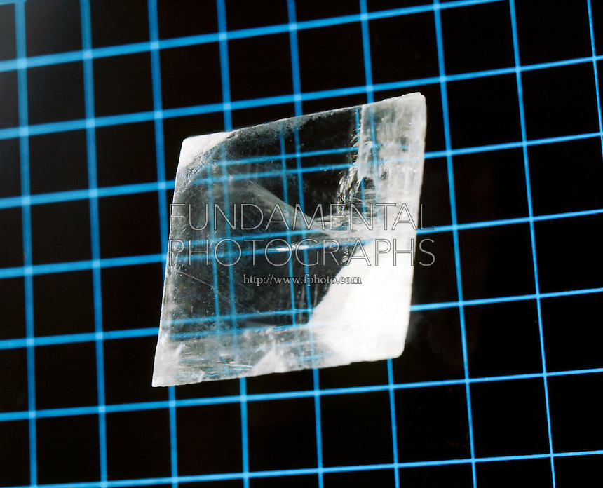 Iceland Spar Variety, Calcium Carbonate (CaCO3)<br /> Double refraction occurs when a ray of light enters the crystal it is split into fast and slow beams. As these two beams exit the crystal they are bent into two different angles because the angle is affected by the speed of the beams.