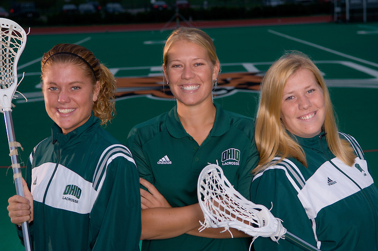 Lacrosse photo with players Julie and Lauren Roguski and Coach Jess Roguski