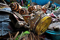 A discarded carnival sculpture of a royal crown thrown into a pile in the Samba school warehouse in Rio de Janeiro, Brazil, 13 February 2012. Most of the large carnival floats, colorful designs and fancy costumes are dismantled, cut into pieces or simply thrown into garbage right after the last day of the Carnival. The low-tech materials as fiberglass, plastic or polystyrene, which most of the of the carnival floats and statues are made of, are stocked in the warehouses to be recycled and used in the future parades. However, there is no use for some of the statues so they slowly fall apart into pieces forming a ?Carnival cemetery? in the industrial yards around the port of Rio de Janeiro.