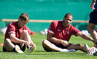 Brian McBride, left, and Oguchi Onyewu, right, stretch before training in Hamburg, Germany, for the 2006 World Cup, June, 8, 2006.