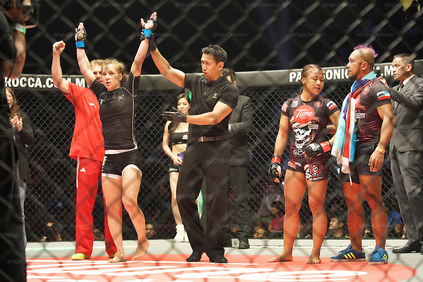 Irina Mazepa, 5X Wushu World Champion, knocked out Ann Osman, Malaysia WMMA star<br /><br />MMA. Mixed Martial Arts &quot;Tigers of Asia&quot; cage fighting competition. Top professional male and female fighters from across Asia, Russia, Australia, Malaysia, Japan and the Philippines come together to fight. This tournament takes place in front of a ten thousand strong crowd of supporters in Pelaing Stadium. Kuala Lumpur, Malaysia. October 2015