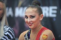 """Daria Kondakova of Russia smiles from """"kiss & cry"""" during event finals at 2010 Grand Prix Marbella at San Pedro Alcantara, Spain on May 16, 2010. Daria won silver in AA at Marbella 2010. (Photo by Tom Theobald)."""
