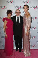 """L-R Myra Biblowit, Dr. Larry Norton and Kinga Lampert attend The Breast Cancer Research Foundation """"Super Nova"""" Hot Pink Party on May 12, 2017 at the Park Avenue Armory in New York City."""